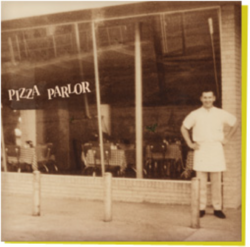 Ken Selby in front of Pizza Parlor